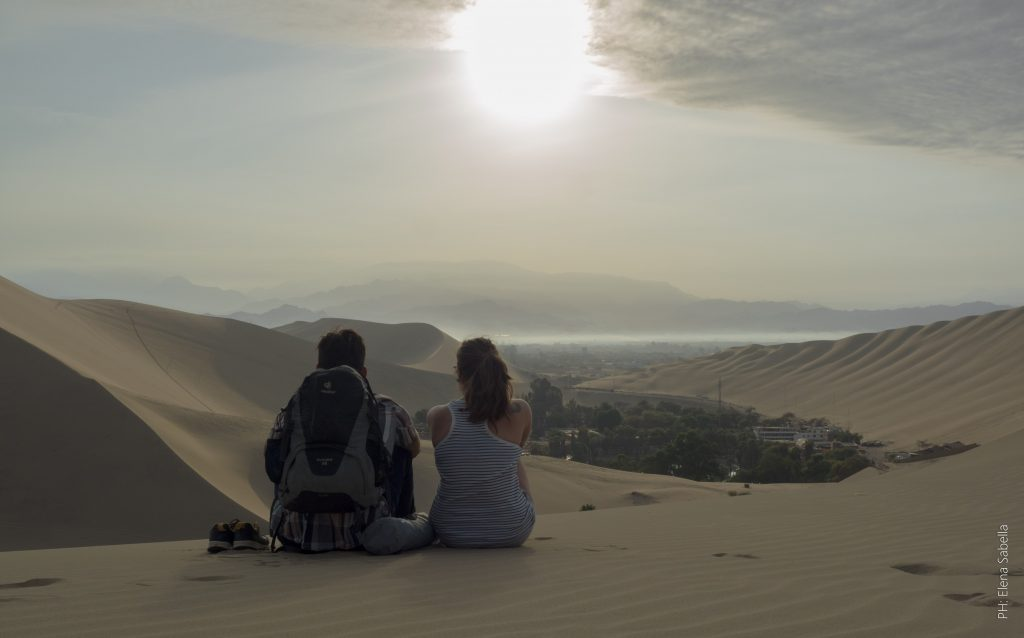 Watching the sunrise with my Couchsurfing host in Huacachina, Peru